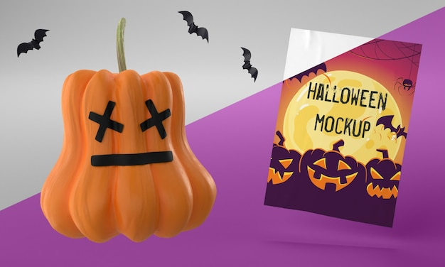 Halloween-kartenmodell neben gruseligem kürbis