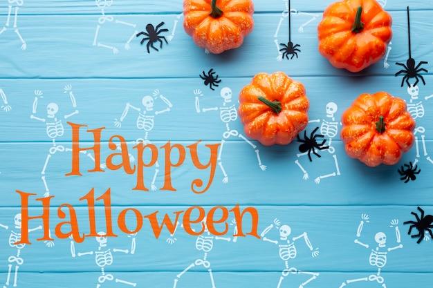 Halloween-kürbisse und zeichenskelett