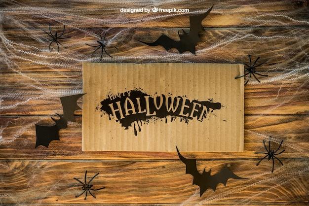 Halloween mockup mit karton auf spinngewebe