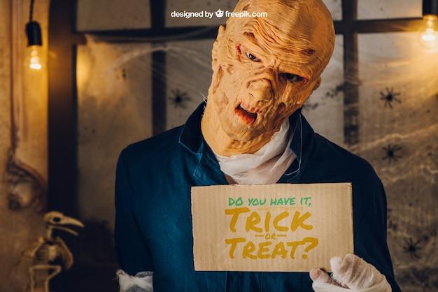 Halloween mockup mit monster zeigt karton