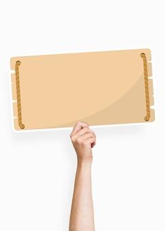 Hand, die eine leere signagepappstütze hält