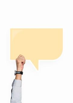 Hand, die eine spracheblasengraphik anhält