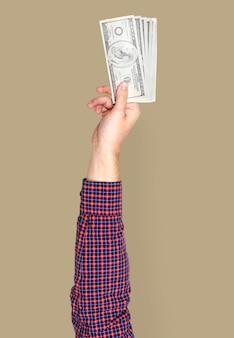 Hand, die geld hält