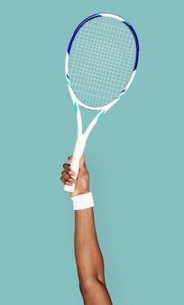 Hand, die tennisschläger hält