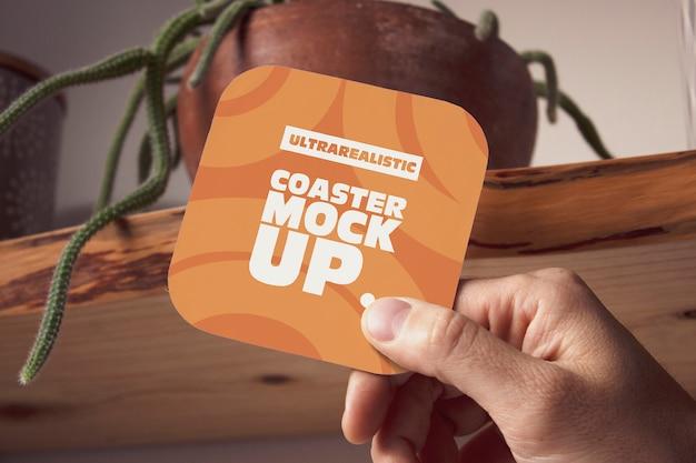 Hand square coaster mockup