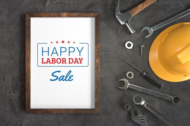 Happy labour day sale mit fotorahmenmodell und handwerkzeugen