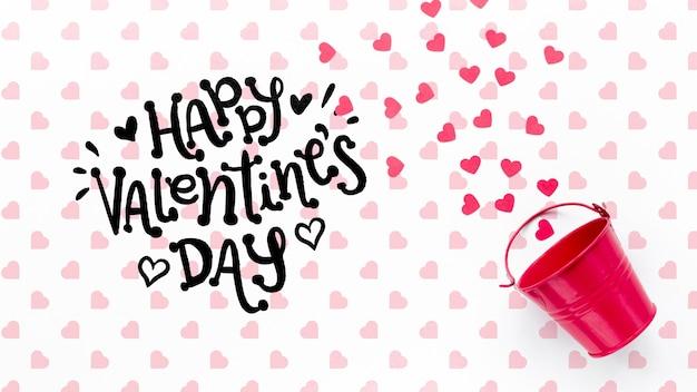 Happy valentinstag schriftzug mit rosa eimer