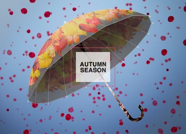 Herbstsaisonhintergrund mit einem regenschirm