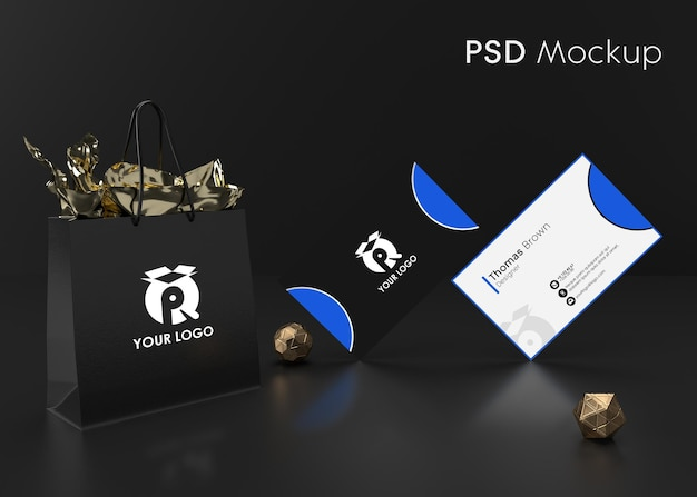 Hintergrund schwarz moderne visitenkarte und geschenkverpackungstasche bereit für mockup