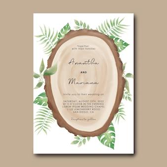 Hochzeitseinladungsschablone mit holzscheibenentwurf und tropischen aquarellblättern