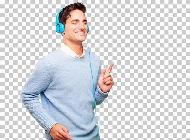 Hörende musik des jungen hübschen gebräunten mannes mit kopfhörer