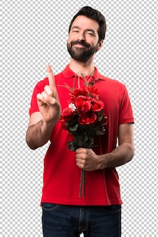 Holdingblumen des gutaussehenden mannes, die eine zählen
