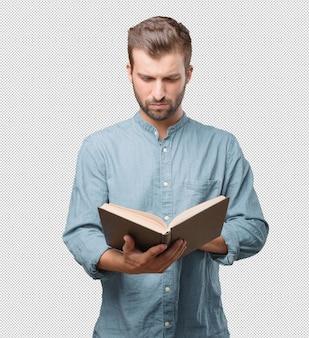 Hübsche lesung des jungen mannes im buch