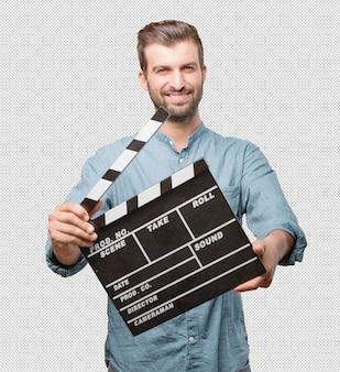 Hübscher junger mann mit filmklappe