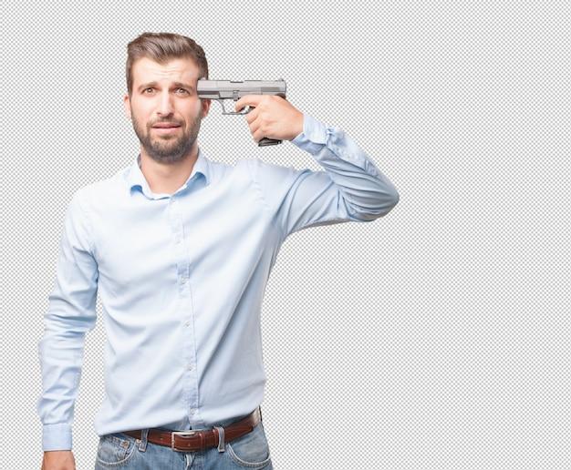 Hübscher junger mann mit pistole
