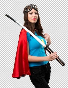 Hübsches superheldmädchen mit katana