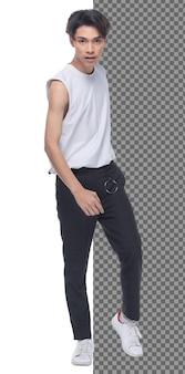 In voller länge teenager 15s 20s asian boy tragen weste kleid und jeanshose sneaker, isoliert. schlanker gesunder mann steht und schaut selbstbewusst in die kamera, kurzes schwarzes haar, weißer studiohintergrund