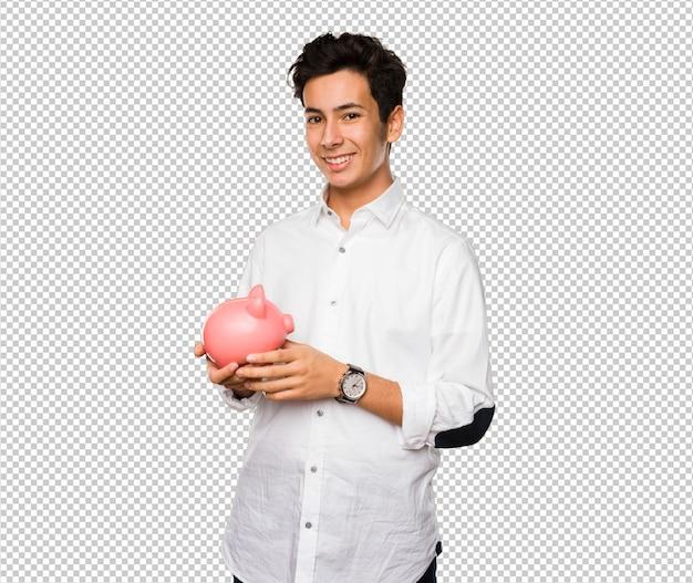 Jugendlicher, der ein sparschwein hält