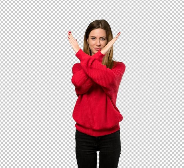 Junge frau mit der roten strickjacke, die keine geste macht