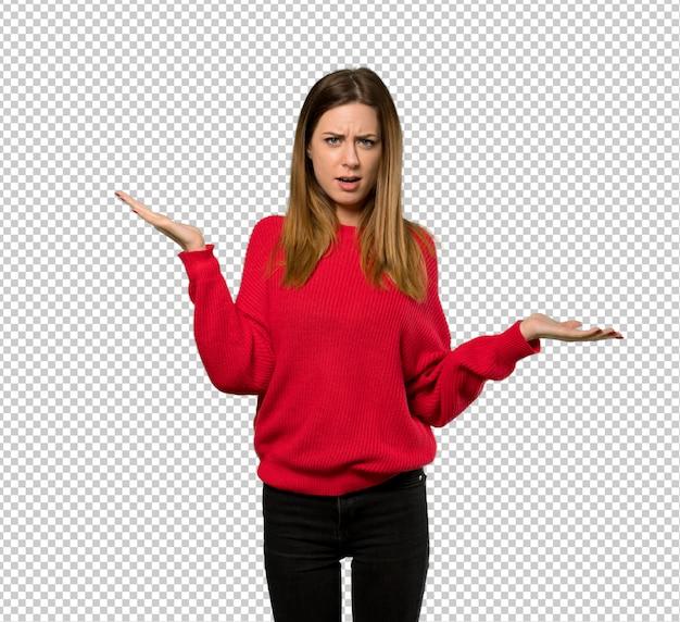 Junge frau mit der roten strickjacke unglücklich, weil etwas nicht verstehen