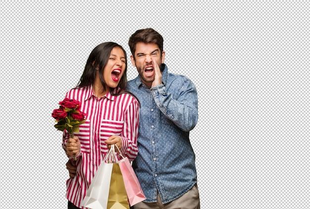 Junge paare am valentinsgrußtag etwas glücklich schreiend zur front