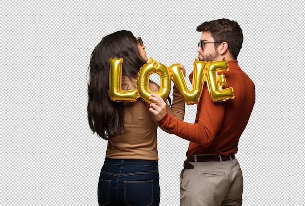 Junge paare im valentinsgrußtag von hinten denkend an etwas