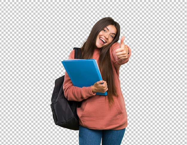 Junge studentenfrau, die notizbücher mit den daumen oben hält, weil etwas gutes geschehen ist