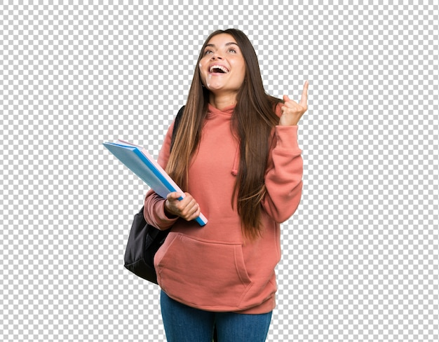 Junge studentenfrau, welche die notizbücher oben zeigen und überrascht hält