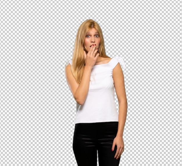 Junger blondinebedeckungsmund mit den händen für das unangemessenes etwas