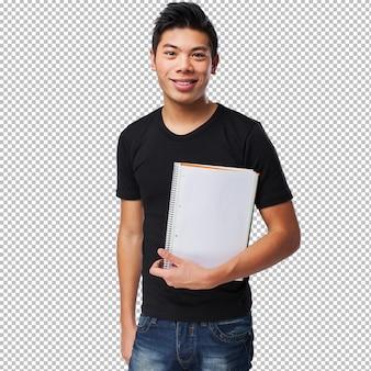Junger chinesischer mann, der sein notizbuch anhält