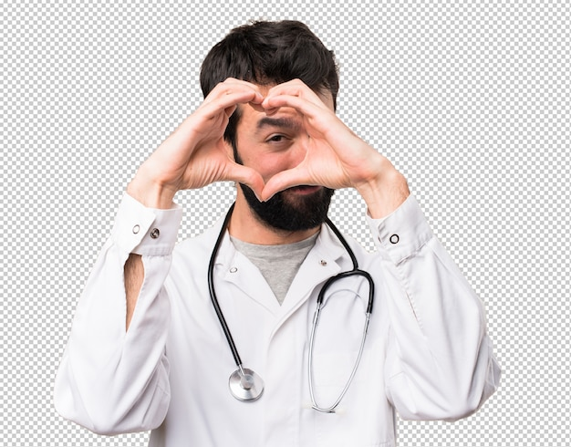 Junger doktor, der ein herz mit seinen händen macht