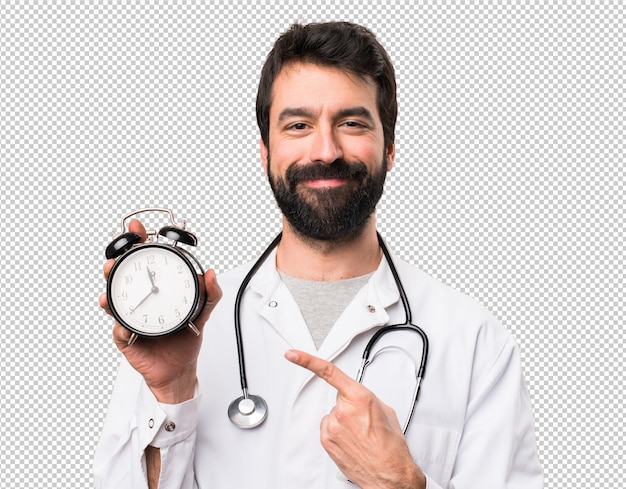 Junger doktor, der weinleseuhr hält