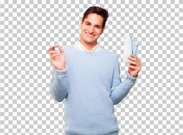 Junger hübscher gebräunter mann mit bordkartekarten