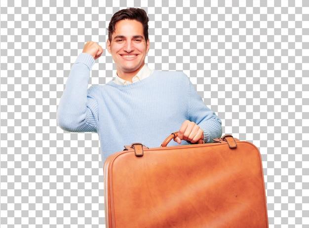 Junger hübscher gebräunter mann mit einem ledernen fallgepäck