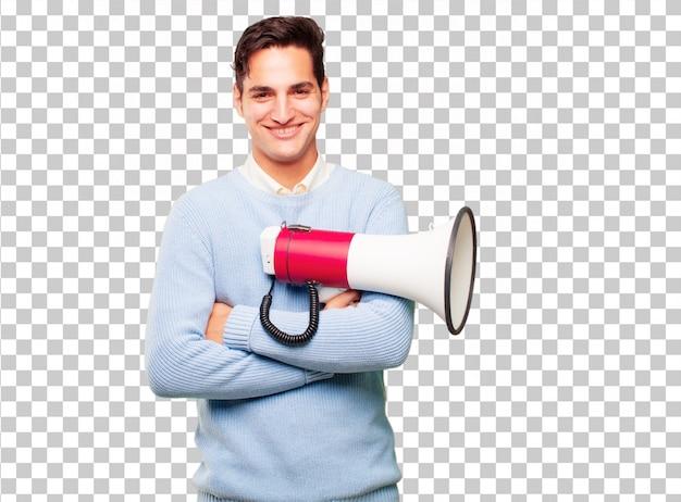 Junger hübscher gebräunter mann mit einem megaphon