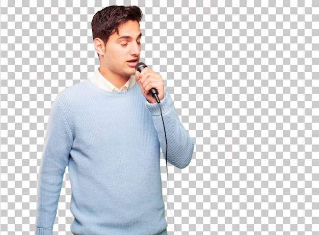 Junger hübscher gebräunter mann mit einem mikrofon