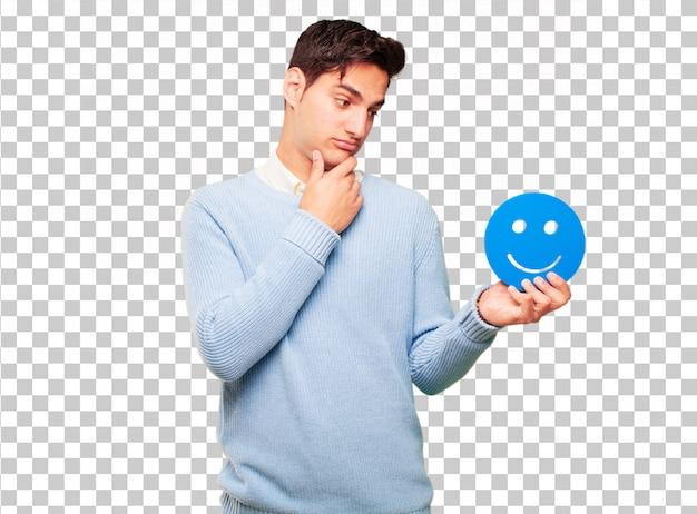 Junger hübscher gebräunter mann mit einem smiley emoticon