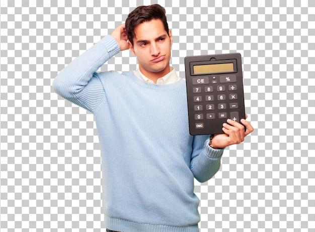 Junger hübscher gebräunter mann mit einem taschenrechner