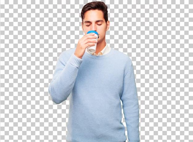 Junger hübscher gebräunter mann mit einem wegnehmenden kaffee