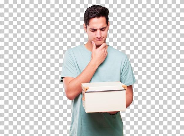 Junger hübscher gebräunter mann mit einem weinlesekasten