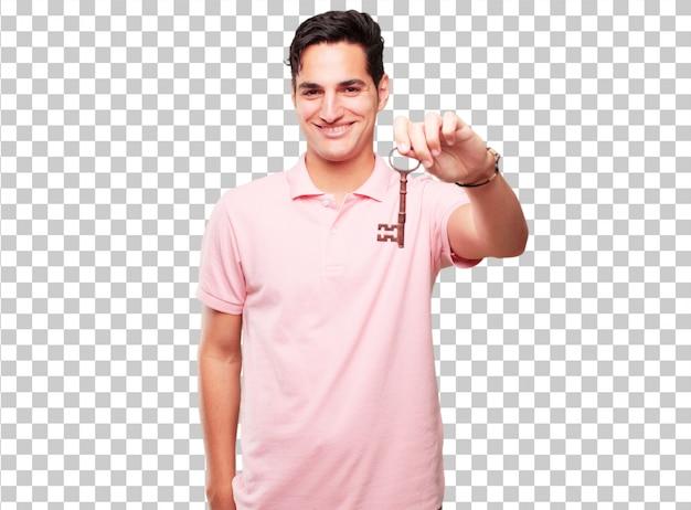 Junger hübscher gebräunter mann mit einem weinleseschlüssel