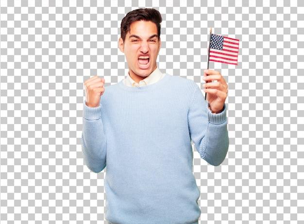 Junger hübscher gebräunter mann mit einer usa-flagge