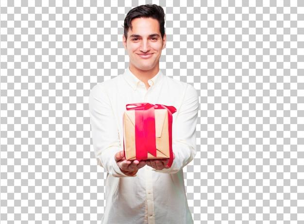 Junger hübscher gebräunter mann mit geschenkboxkonzept
