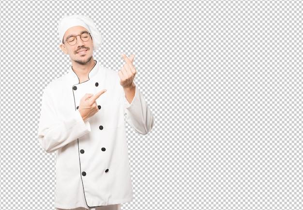 Junger koch, der eine geste der sorge um seine wirtschaft macht