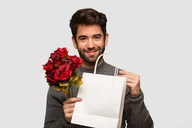 Junger mann, der valentinsgrußtag feiert