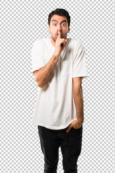 Junger mann mit dem weißen hemd, das ein zeichen des schließmunds zeigt