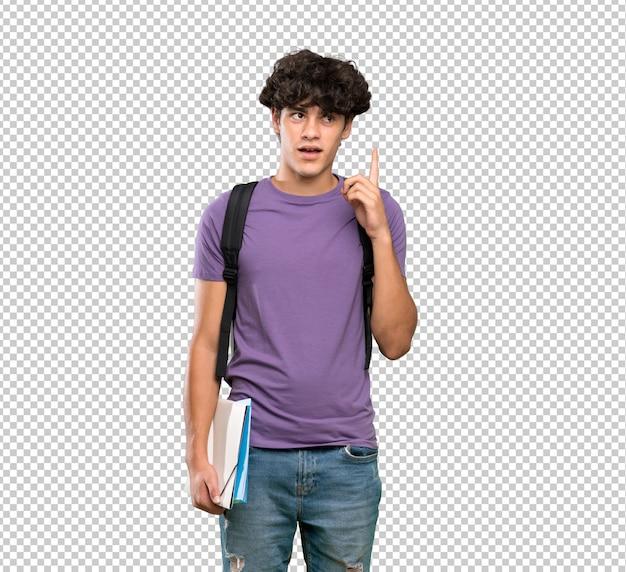 Junger studentenmann, der eine idee zeigt den finger oben denkt