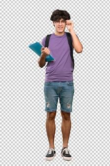 Junger studentenmann mit gläsern und überrascht