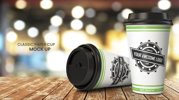 Kaffeepapierschalenmodell auf hölzernem cafetable, psd-modell oben