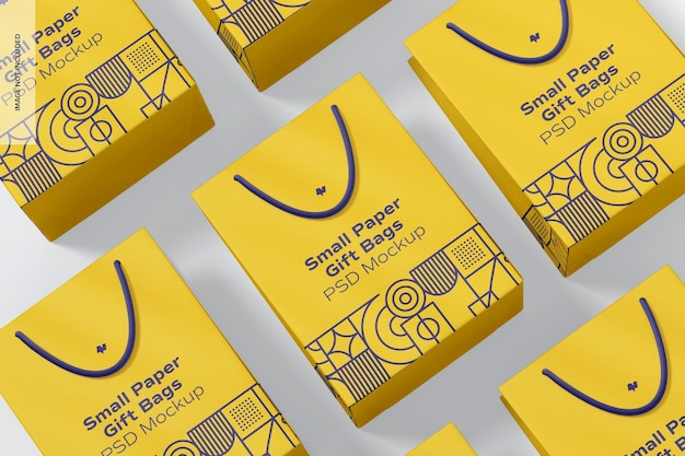 Kleine papiergeschenktüten mit seilgriff-set mockup